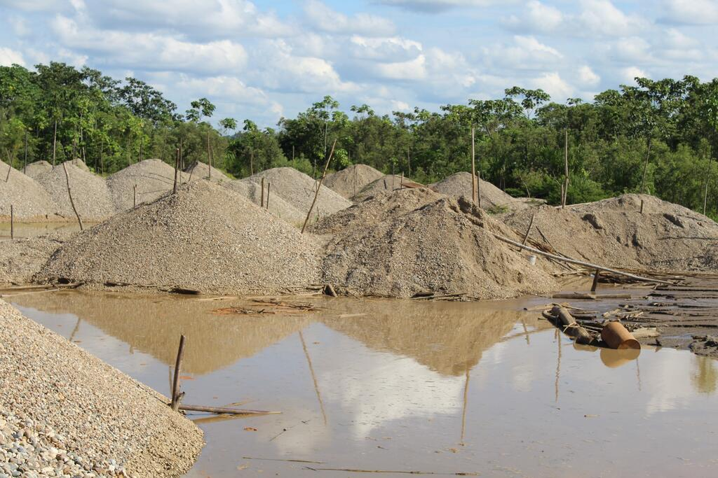 Damage to oxbow lake bank caused by gold mining in Peru.