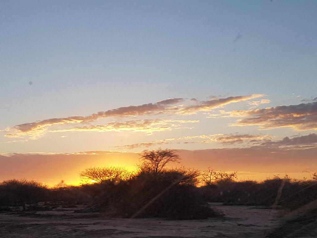 Sunset in Garissa county at the end of day 1 on the journey to the Ishaqbini Hirola Conservancy.