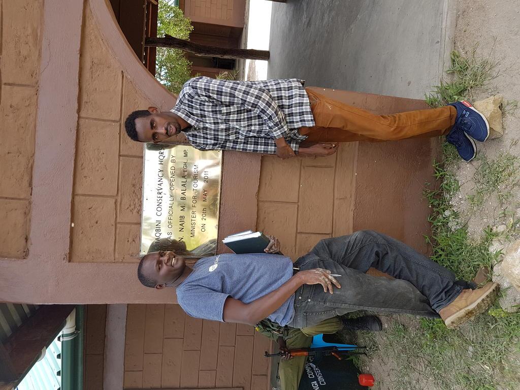 Arrival at Ishaqbini. Dr. Stephen Chege [left] and interim veterinary technician Mr. Omar [right].