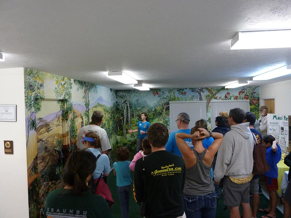 The author acting as tour guide, giving visitors the inside story about the birds being bred at KBCC.