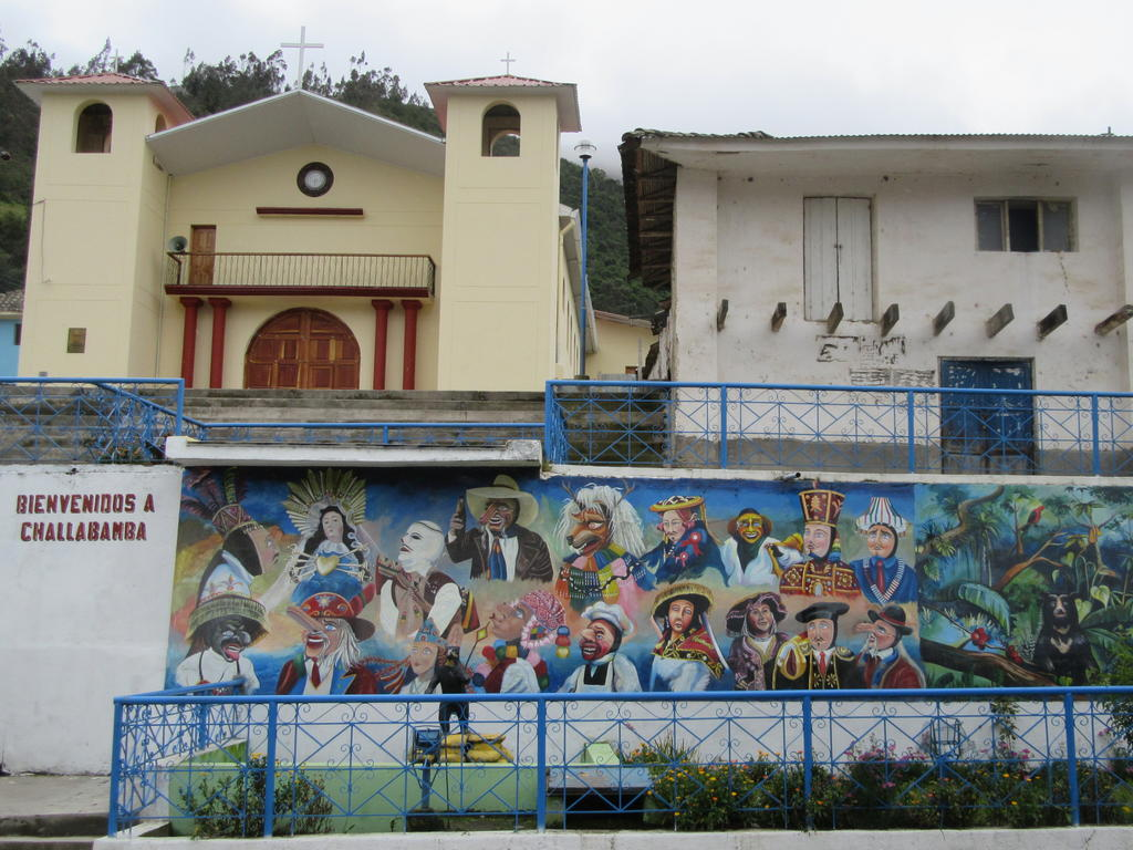 Below the church in the town of Challabamba is a statue of an Andean bear, a mural with various traditional folk figures including an ukuku (in white mask above the bear statue), and a mural of an Andean bear in the cloud forest (far right). Photo by Russ Van Horn.