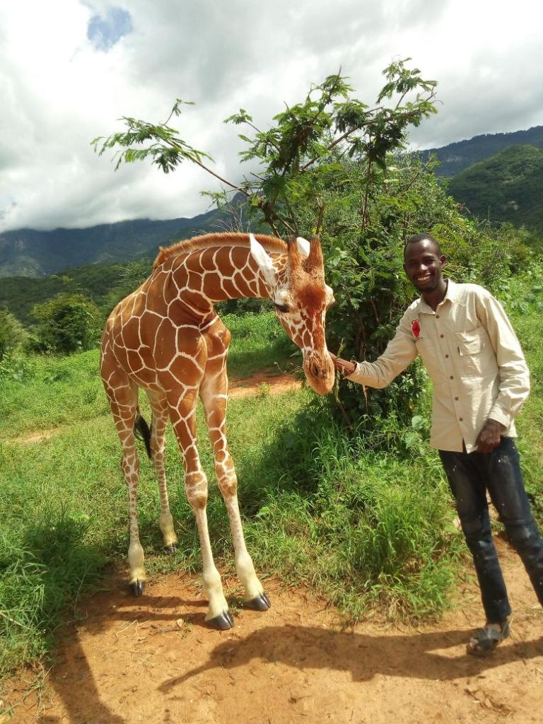 Jesus, a research assistant with the Namunyak Twiga Walinzi team, greets Lekiji. Photo: Twiga Walinzi