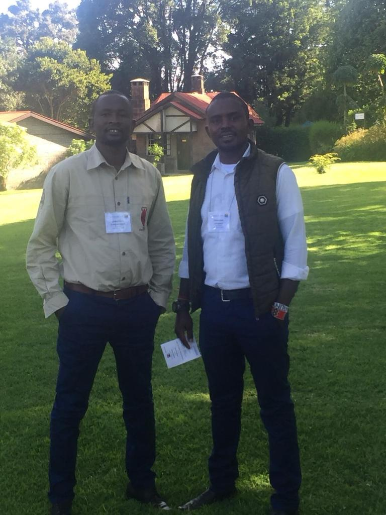The authors at the Pathways Conference in Nairobi before the country imposed lockdown measures.