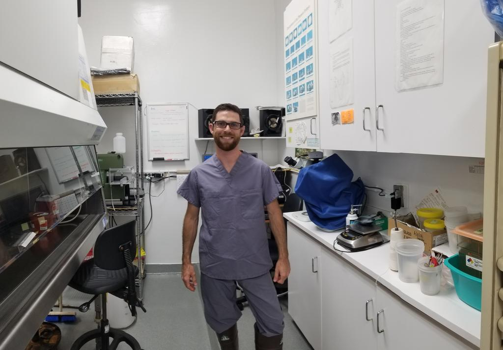 Pathology technician Scott Daugherty stands with equipment in the necropsy lab.  Photo: Joanna C Volavka