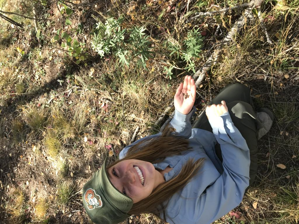 Myself, with a handful of hare pellets. Who knew poop could help tackle complex conservation issues?