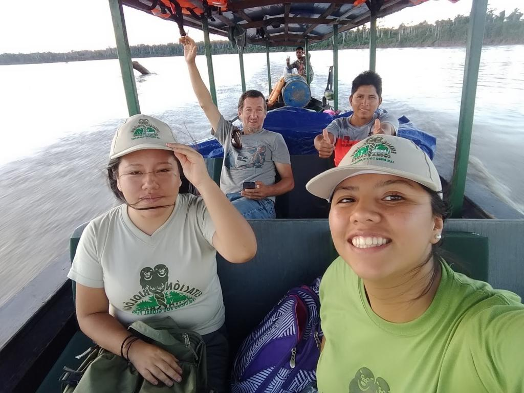 The SDZG Peru human dimensions team on a boat movement between communities in the gold mining zone. (Photo by Berenice Mendoza)