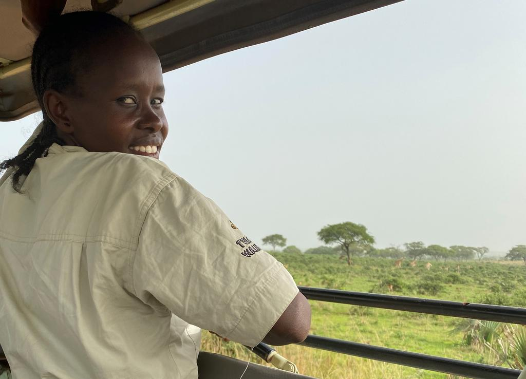 Ruth and a tower of Nubian giraffe in Murchison Falls National Park, Uganda.