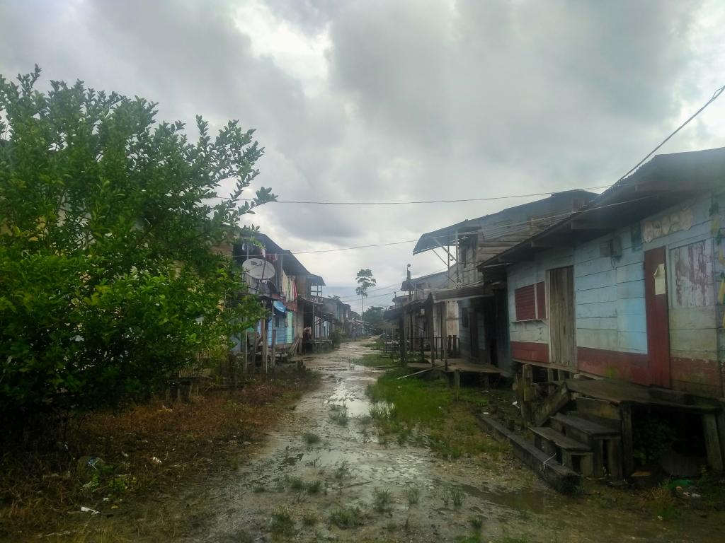 One of the streets of a gold mining community in the Madre de Dios province, Peru.